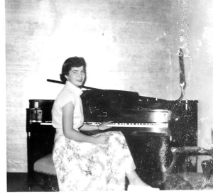 Mom at a piano, not the one I mention - and long before she was 'mom'.